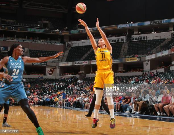 Natalie Achonwa of the Indiana Fever shoots the ball against Sylvia Fowles of the Minnesota Lynx on August 30 2017 at Bankers Life Fieldhouse in...