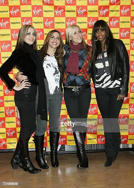 Natalie Appleton Melanie Blatt Nicole Appleton Shaznay Lewis of the group All Saints pose before signing copies of their new single 'Rock Steady' at...