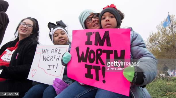 Natalie Armstrong and her two daughters Payton and Payzlyn along with her mother Katrina Sinor rally at the state capitol on April 2 2018 in Oklahoma...