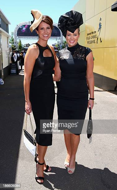Natalie Barr and Samantha Armytage arrive on Victoria Derby Day at Flemington Racecourse on November 2 2013 in Melbourne Australia