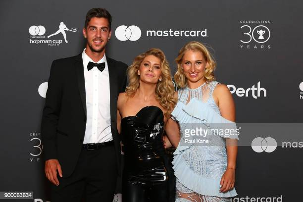 Natalie Bassingthwaighte of the Rogue Traders poses with Thanasi Kokkinakis and Daria Gavrilova of Australia at the 2018 Hopman Cup New Years Eve...