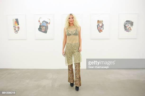 Natalie Bergman poses in front of her artwork at OptiMystic A Brandon Boyd Pop Up Gallery Featuring He Tasya Van Ree Natalie Bergman Diana Garcia And...