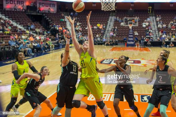 Natalie Butler of the Dallas Wings and Shoni Schimmel of the New York Liberty challenge for a rebound during the Dallas Wings Vs New York Liberty...