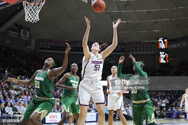 Natalie Butler of the UConn Huskies rebounds while challenged by Kalani Brown of the Baylor Bears and Alexis Jones of the Baylor Bears during the...