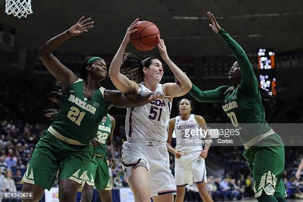 Natalie Butler of the UConn Huskies reopens while challenged by Kalani Brown of the Baylor Bears and Alexis Jones of the Baylor Bears during the...