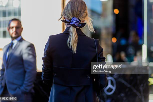 Natalie Cantell wearing a black blazer clutch bandana in her hair and white button shirt and Ray Ban sunglasses at MercedesBenz Fashion Week Resort...