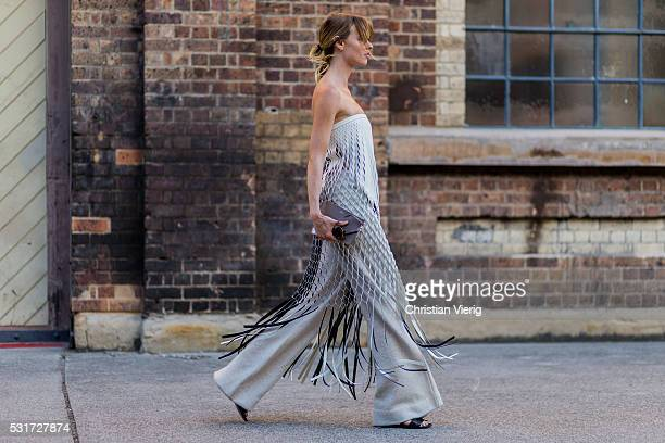 Natalie Cantell wearing a grey dress with fringes from Dion Lee and a Furla clutch outside Misha Collection at MercedesBenz Fashion Week Resort 17...