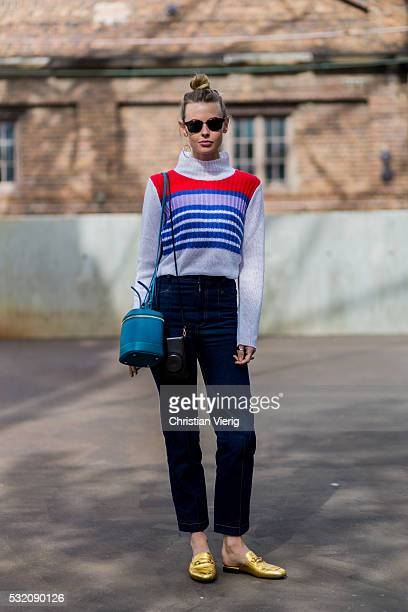 Natalie Cantell wearing a red blue white striped weater and dark blue denim jeans and golden Gucci slippers outside C Meo Collective at MercedesBenz...