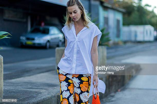 Natalie Cantell wearing a white sleeveless blouse pants with floral print and a fishnet bag at MercedesBenz Fashion Week Resort 17 Collections at...