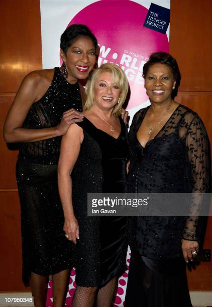 Natalie Cole Elaine Paige and Dionne Warwick attend The Hunger Project Concert afterparty at the Park Plaza Hotel on January 9 2011 in London England...