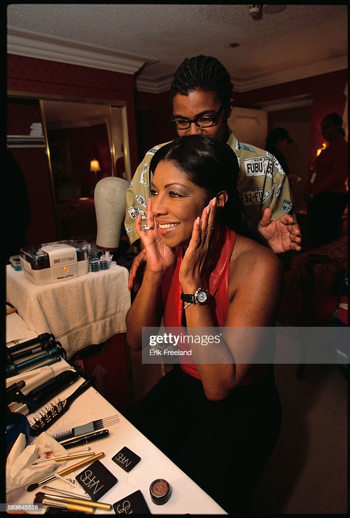 Natalie Cole is visited by her son, Robbie Yancy, as she gets ready for her performance at Bally's in Atlantic City, New Jersey, circa 1995.