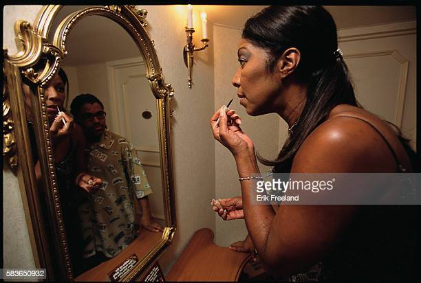 Natalie Cole is visited by her son Robbie Yancy as she gets ready for her performance at Bally's in Atlantic City New Jersey circa 1995