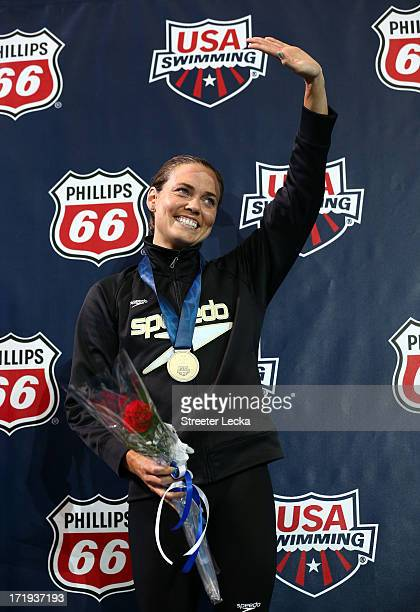 Natalie Coughlin celebrates after winning the 50m freestyle finals on day 5 of the 2013 USA Swimming Phillips 66 National Championships and World...
