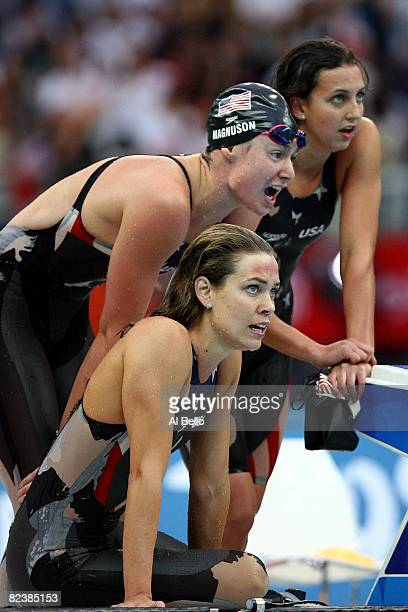 Natalie Coughlin Christine Magnuson and Rebecca Soni of the United States cheer on teammate Dara Torres 9not pictured in the Women's 4x100 Medley...
