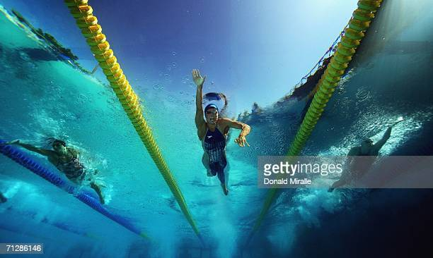 Natalie Coughlin of the USA swims to win in the Women's 100M Freestyle Final as her teammate Erin Reilly and Mary Descenza swim behind during the...