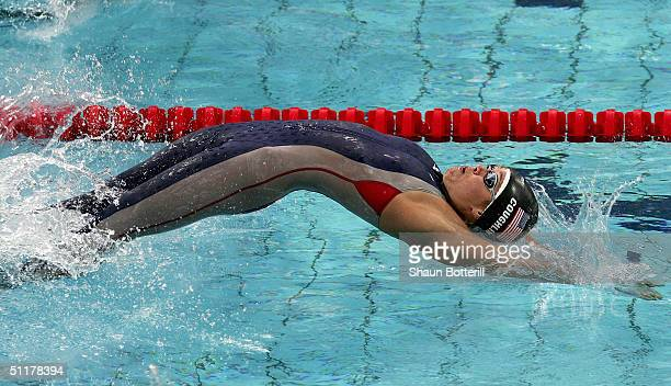 Natalie Coughlin of USA competes in the women's swimming 100 metre backstroke final on August 16, 2004 during the Athens 2004 Summer Olympic Games at...