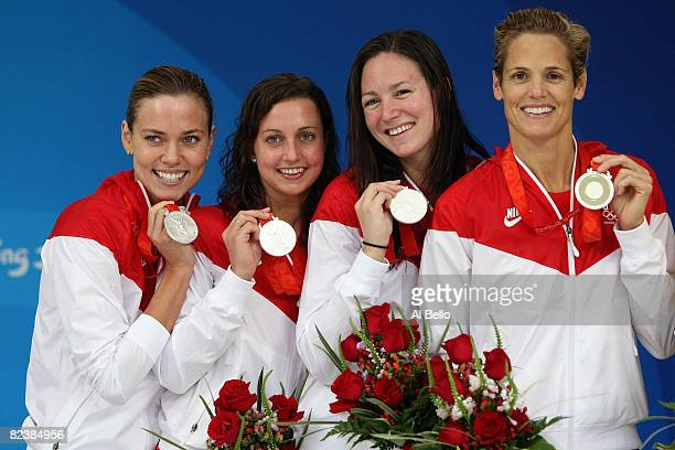 Natalie Coughlin, Rebecca Soni, Christine Magnuson and Dara Torres of the United States hold their silver medals in the Women's 4x100 Medley Relay...