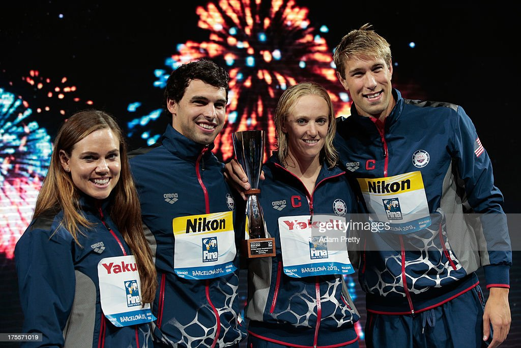 Natalie Coughlin, Ricky Berens, Dana Vollmer and Matt Greevers of the USA celebrate on the podium as they accept the award for 'Best Team' on day sixteen of the 15th FINA World Championships at Palau Sant Jordi on August 4, 2013 in Barcelona, Spain.