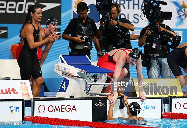 Natalie Coughlin Shannon Vreeland Missy Franklin and Megan Romano of the USA celebrate after the Swimming Women's4x100mFreestyle on day nine of the...