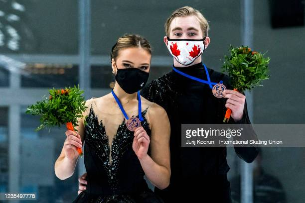 Natalie DAlessandro and Bruce Waddell of Canada pose with the bronze medal during medal ceremony after the ISU Junior Grand Prix of Figure Skating at...
