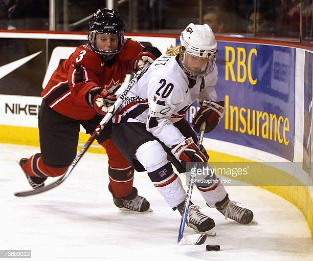 Natalie Darwitz of the USA skates with te puck against Carla Macleod of Canada during the IIHF Women's World Championship Gold Medal game on April 10...