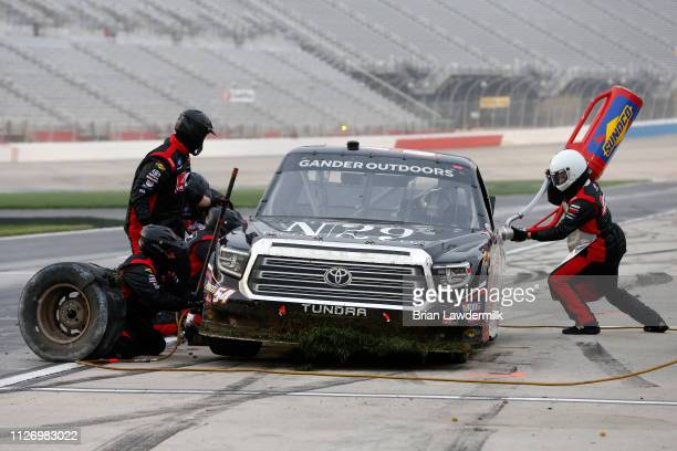 Natalie Decker driver of the N29 Technologies LLC Toyota pits during the NASCAR Gander Outdoors Truck Series Ultimate Tailgating 200 at Atlanta Motor...