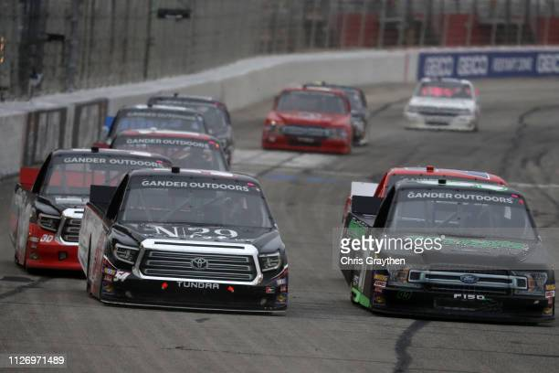 Natalie Decker driver of the N29 Technologies LLC Toyota races Jesse Little driver of the SkuttleTght/PrkrFbrNt/VisitKingsportTN Ford during the...