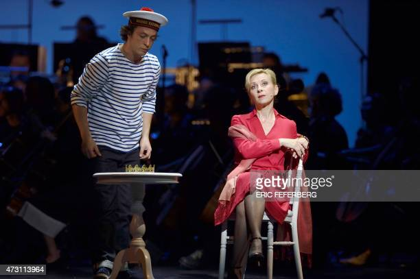 Natalie Dessay playing the role of Madame Emery performs with Franck Lopez in Les Parapluies de Cherbourg at the Chatelet Theatre in Paris on...