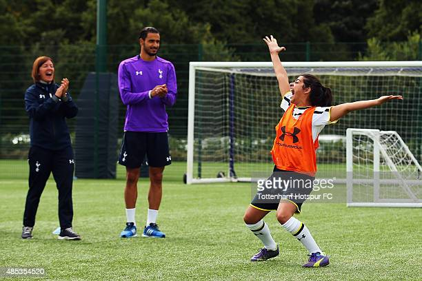 Natalie Dew of Bent it Like Beckham celebrates after taking a free kick as Nacer Chadli of Spurs and Spurs Ladies Head Coach Karen Hills look on...