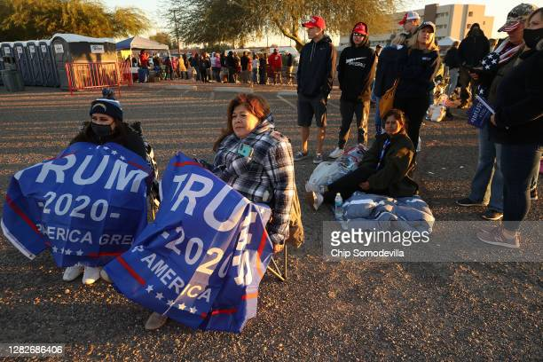 Natalie Dohrer and her mother Rosio Llamas of Temecula, California, wait in line with several hundred others to attend a campaign rally with U.S....