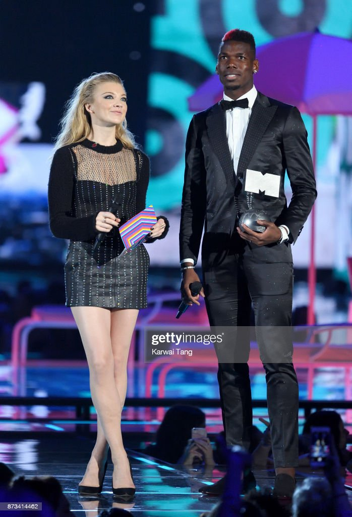 Natalie Dormer and Paul Pogba present on stage during the MTV EMAs 2017 held at The SSE Arena, Wembley on November 12, 2017 in London, England.