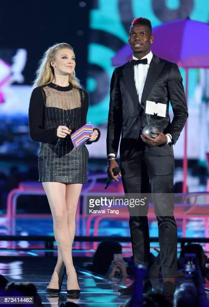 Natalie Dormer and Paul Pogba present on stage during the MTV EMAs 2017 held at The SSE Arena Wembley on November 12 2017 in London England