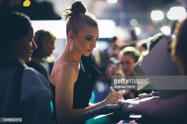 Natalie Dormer writes autographs as she attends the 'Picnic at Hanging Rock' premiere during the 14th Zurich Film Festival at Festival Centre on...