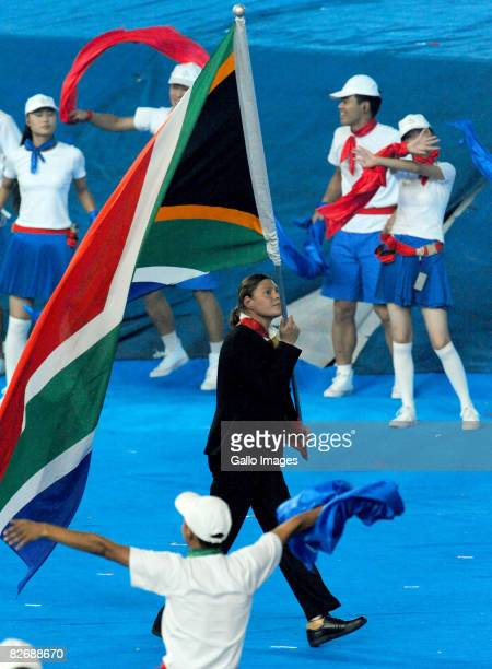Natalie du Toit carries the flag for South Africa during the 2008 Beijing Paralympic Games Opening Ceremony held September 6 2008 in Beijing China