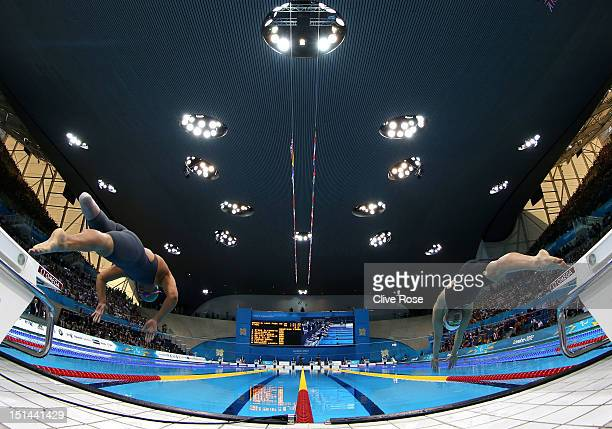 Natalie du Toit of South Africa and Ellie Cole of Australia compete in the Women's 100m Freestyle S9 final on day 9 of the London 2012 Paralympic...