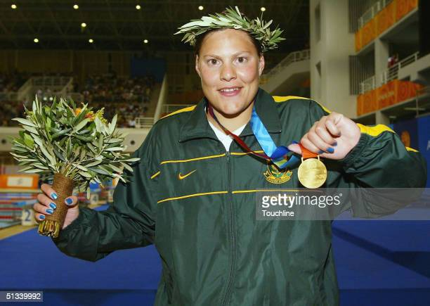 Natalie du Toit of South Africa celebrates with her gold medal after winning the 200 metre individual medley SM9 final during the Athens 2004...