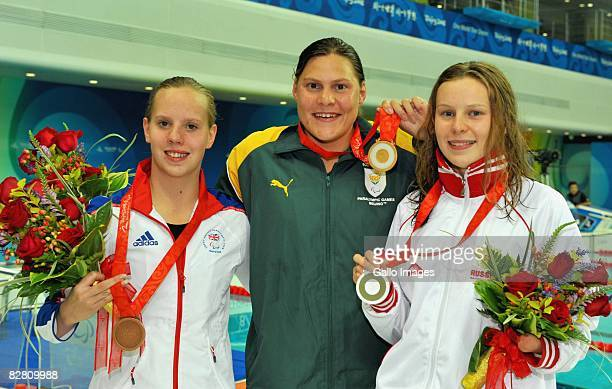 Natalie du Toit of South Africa displays her fifth gold medal with Irina Grazhdanova of Russia winner of the silver and Louise Watkin of Great...