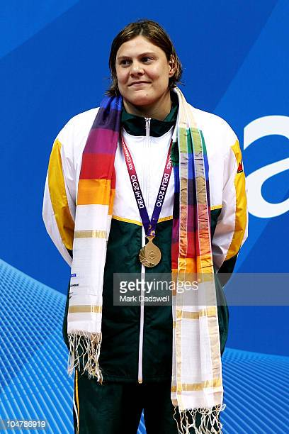 Natalie Du Toit of South Africa poses with the gold medal during the medal ceremony for the Women's 50m Freestyle S9 Final at the Dr SP Mukherjee...