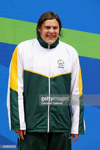 Natalie Du Toit of South Africa poses with the gold medal during the medal ceremony for the Women's 100m Freestyle S9 Final at the Dr SP Mukherjee...