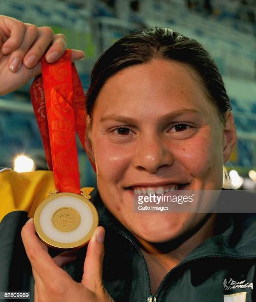Natalie du Toit of South Africa wins her fifth gold medal in the 50m Freestyle S9 at the Beijing National Aquatics Center during day 8 of the 2008...