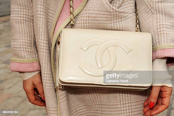 Natalie Fuorvito creative online manager at Riverislandcom accessorising her River Island coat with a vintage Chanel bag during London Fashion Week...
