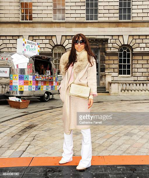 Natalie Fuorvito creative online manager for Riverislandcom wearing a River Island coat and trousers accessorised with a vintage fox fur stole Tom...