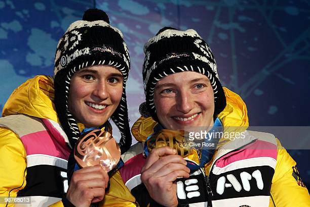 Natalie Geisenberger and Tatjana Huefner of Germany pose for a photo as they celebrate with their medals medal during the medal ceremony for the...