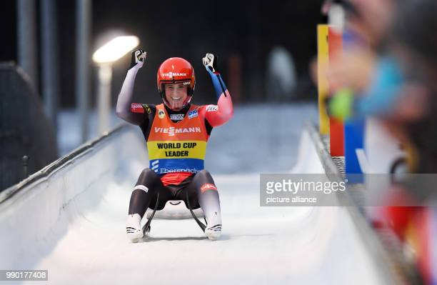 Natalie Geisenberger from Germany celebrates her victory as she passes the finish line at the Luge World Cup in Koenigssee, Germany, 6 January 2018....