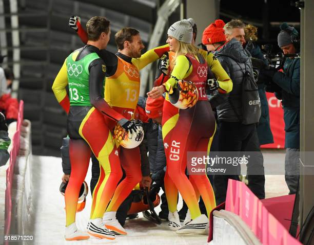 Natalie Geisenberger Johannes Ludwig Tobias Wendl and Tobias Arlt of Germany celebrate winning gold in the Luge Team Relay on day six of the...