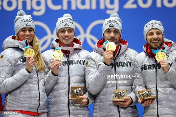 Natalie Geisenberger Johannes ludwig Tobias Wendl and Tobias Arlt from Germany showing their gold medals during the award ceremony of the team luge...