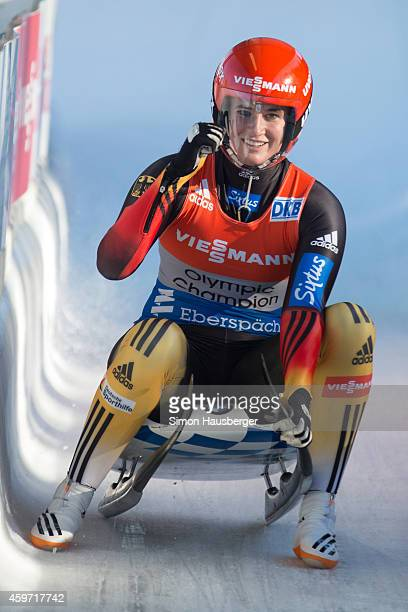 Natalie Geisenberger of Germany celebrates after claiming Victory at the Viessmann Luge World Cup at Olympiabobbahn Igls on November 29 2014 in...