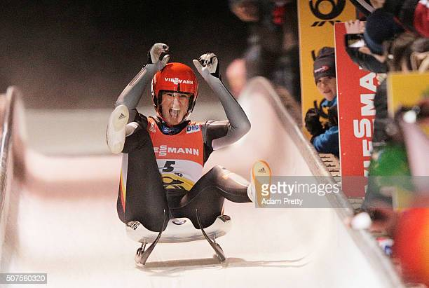 Natalie Geisenberger of Germany celebrates victory in the Women's Luge competition at Deutsche Post Eisarena Koenigssee on January 30 2016 in...