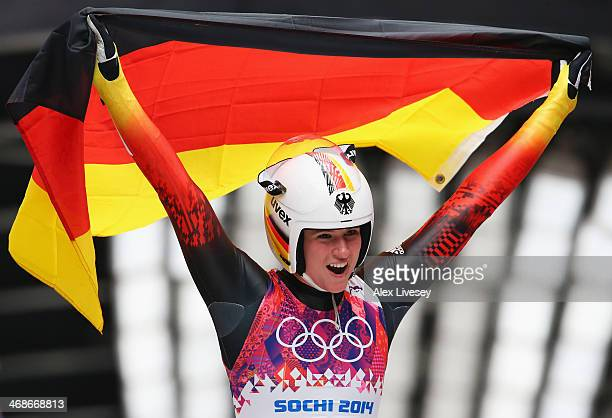Natalie Geisenberger of Germany celebrates winning gold medal after the Women's Luge Singles on Day 4 of the Sochi 2014 Winter Olympics at Sliding...