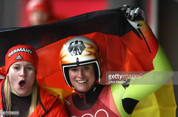 Natalie Geisenberger of Germany celebrates winning the gold medal with silver medalist Dajana Eitberger of Germany during the Luge Women's Singles on...